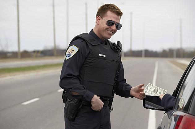 corrupt cop accepting bribe