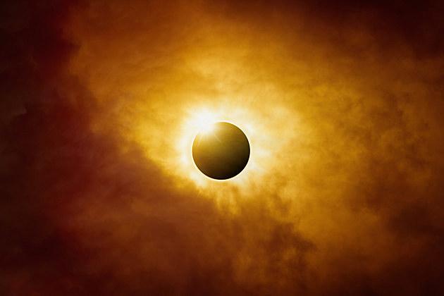 Dramatic scientific background - full sun eclipse in dark red sky